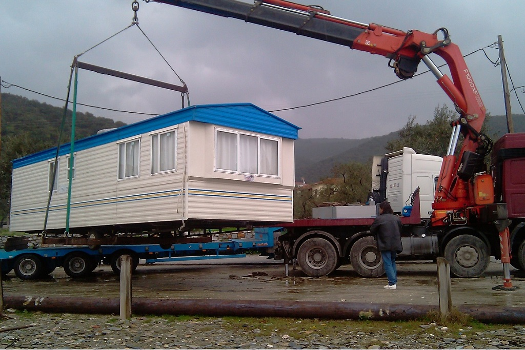 track crane lifting mobile home greece